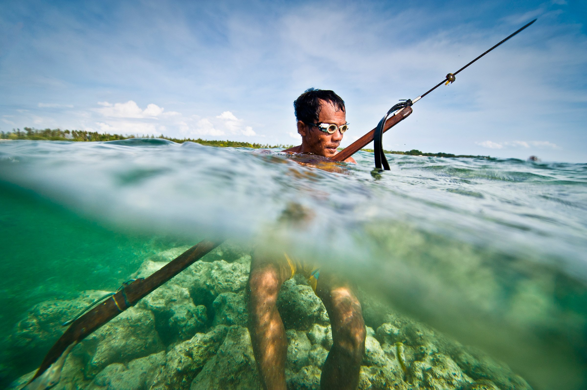 A traditional spear fisher in the tropical waters of Cebu, Philippines.