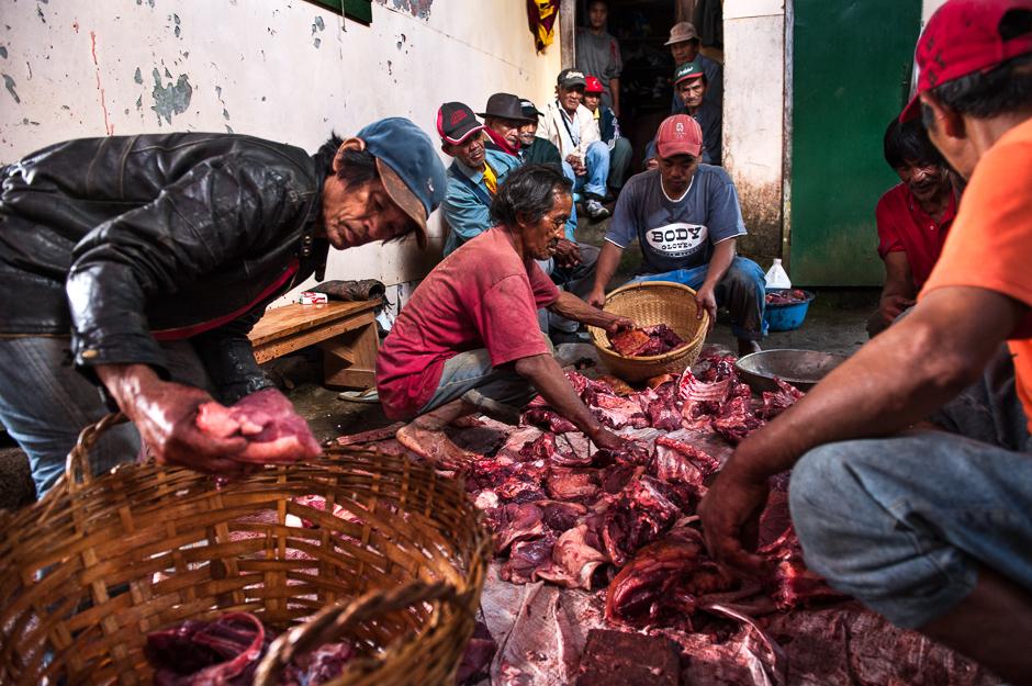Men distributing meat