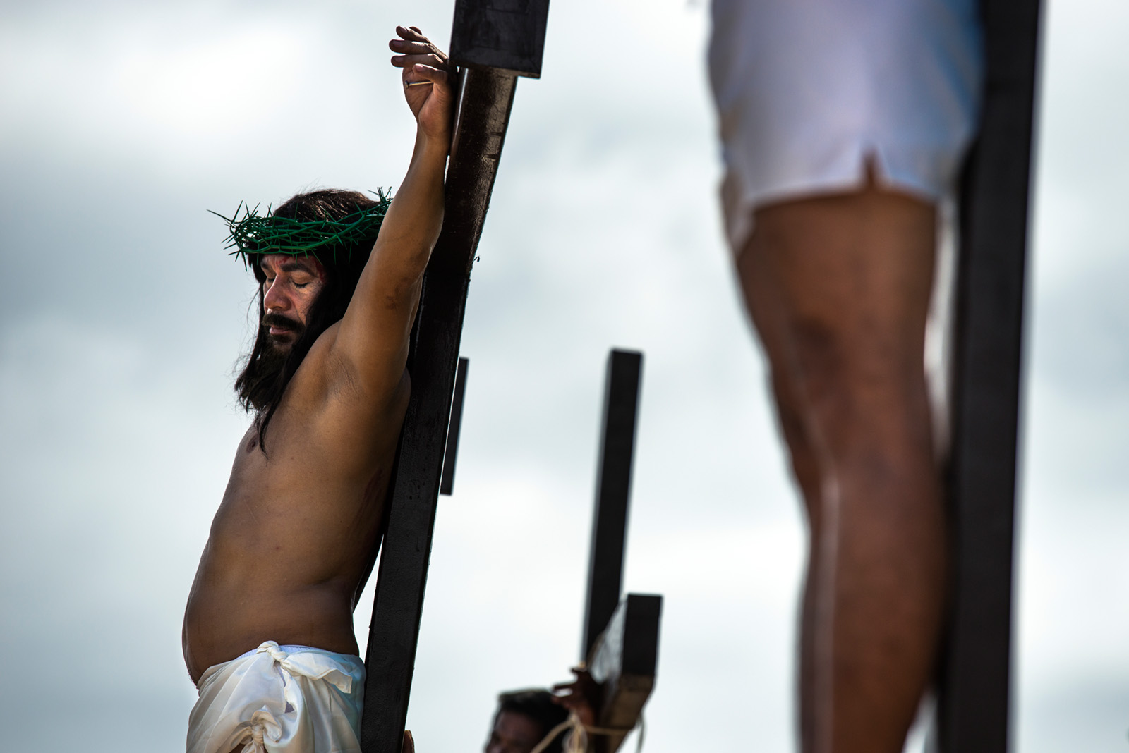 Gilbert Bargayo is crucified for the 19th & 20th time on Good Friday in Tuburan, Cebu, Philippines.
