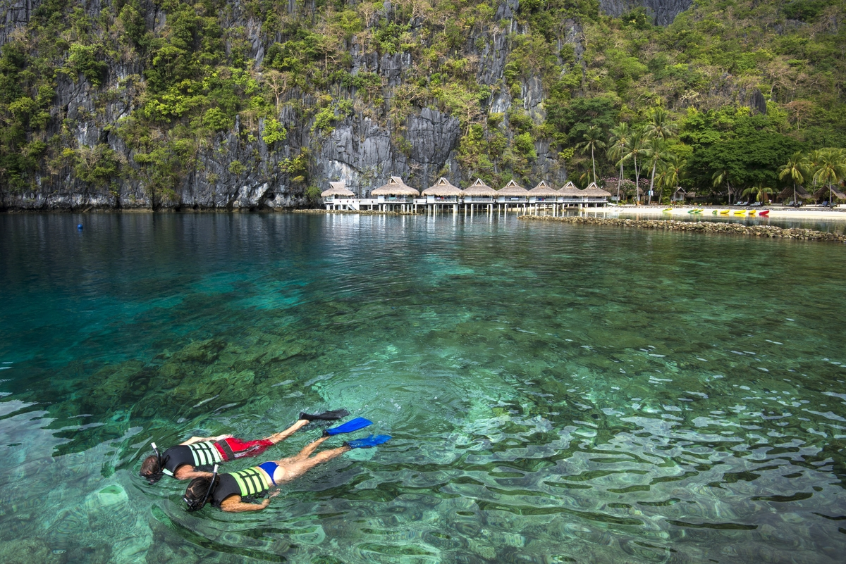 Snorkelers at Miniloc Island Resort