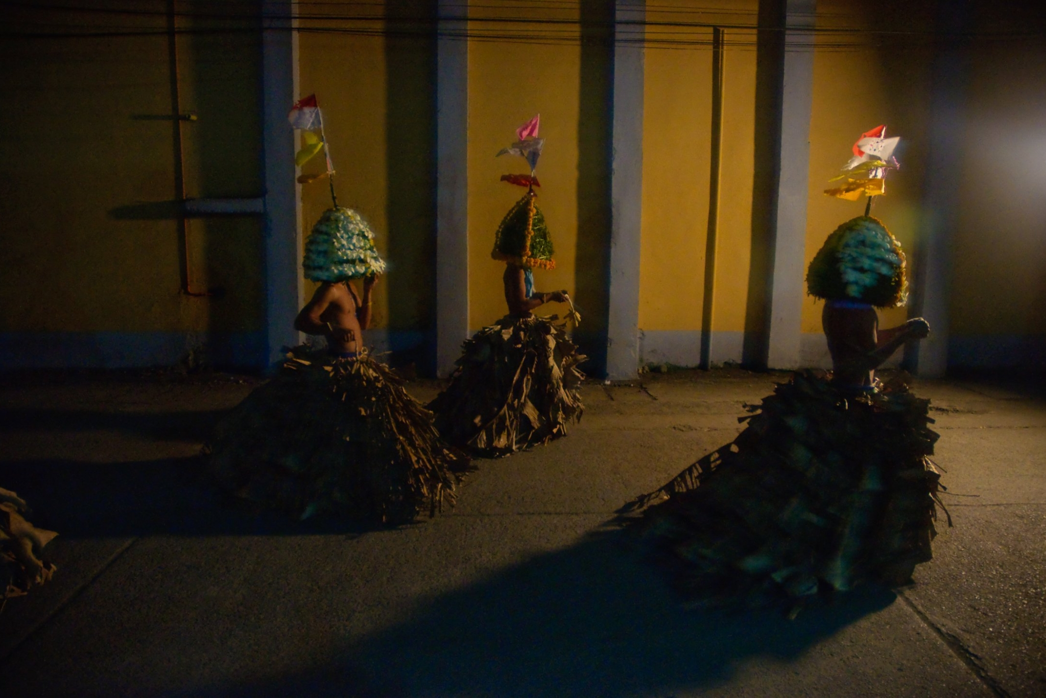 """In the Philippine province of Quezon there are still a number of men who wear elaborate costumes while preforming their act of self flagellation. This unique costume with its colorful headdress called the """"tukarol"""" and its skirt called the """"saya"""" is the last of it's kind in the Philippine Islands. The ritual is preformed during the early hours of Good Friday with preparations taking place at the start of Holy Week."""